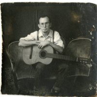 Photo of Man with Guitar