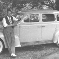 """Ernest """"Buck"""" Hodges and His Oldsmobile"""
