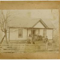 Portrait of Family on House Porch