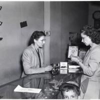 Saleswoman Showing Customer Watches