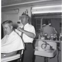 Barber Trimming Man's Hair