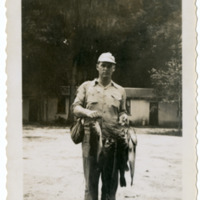Unidentified Man Holding Fish