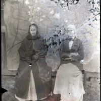 Two Women Seated for Portrait in Front of Map