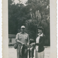 Unidentified Man and Woman Holding Fish