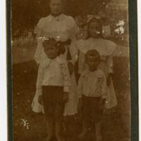 Portrait of Woman with Three Children