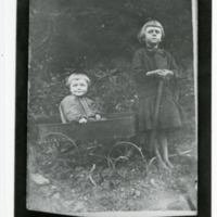 Two Young Girls with Wagon